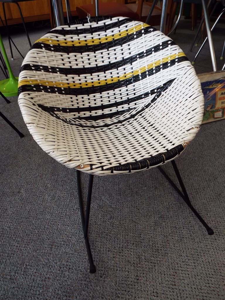 1960s woven plastic saucer rocking chair
