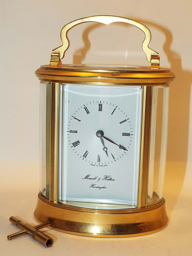 English gilt brass carriage clock