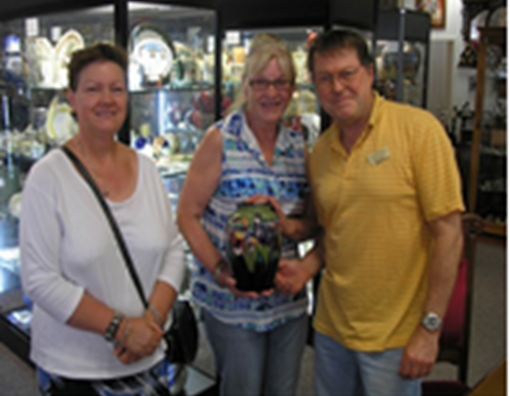 Sisters Christine and Deborah of Queanbeyan with their William Moorcroft 'Orchids' baluster vase. Value approximately $1,700. Pictured with Doug Mulley of Ellavale Collectables.