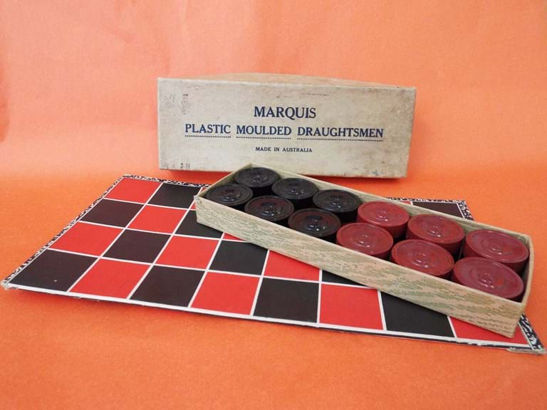 Boxed bakelite draughts set and board