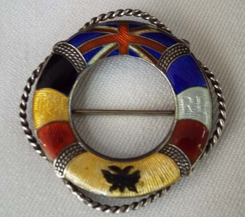 Silver and enamel nautical theme brooch