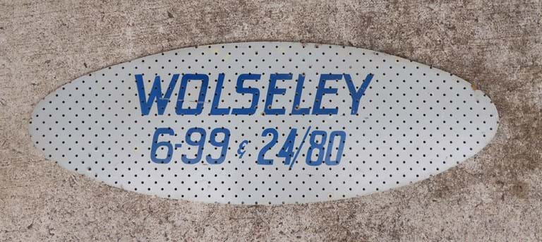 c1960s motor vehicle advertising sign Wolseley