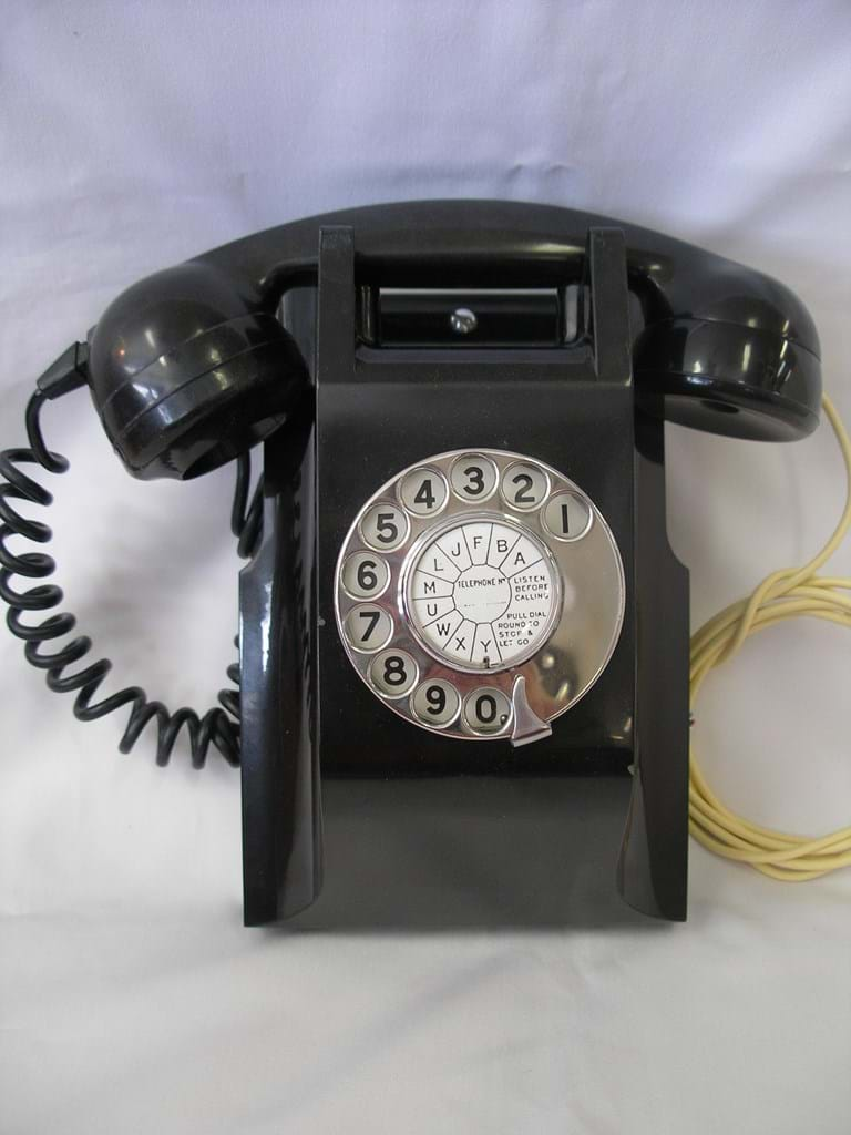 1930s bakelite wall telephone with rotary dial