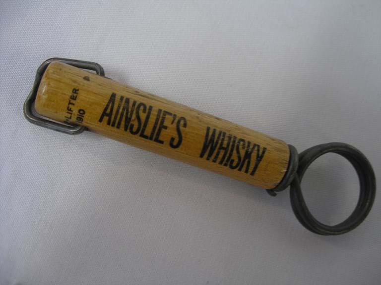 Ainslie's whisky advertising corkscrew