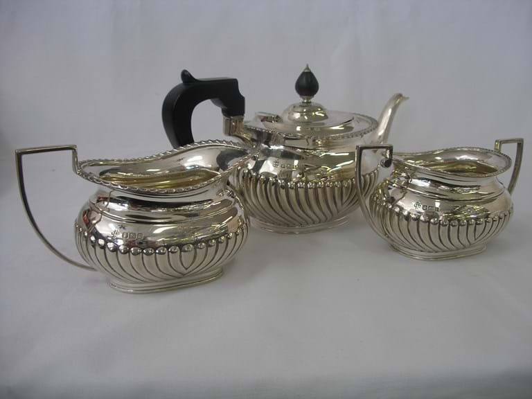 Early 20th century three piece sterling silver bachelors teaset