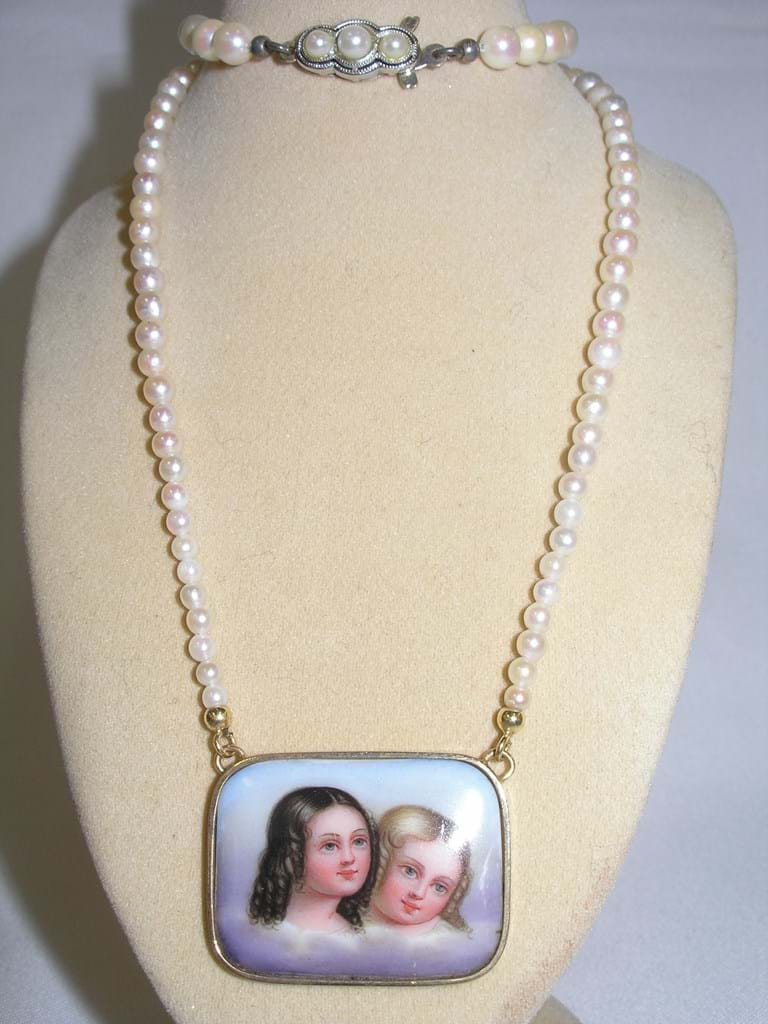 Pearl necklace with 14 carat gold clasp and Victorian painted portrait