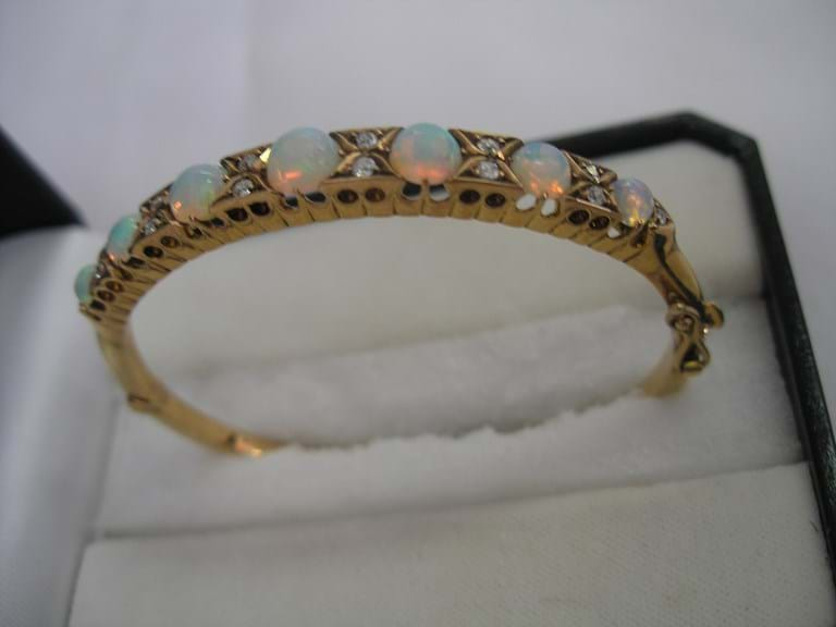 15 carat yellow gold bangle with solid opals and diamonds