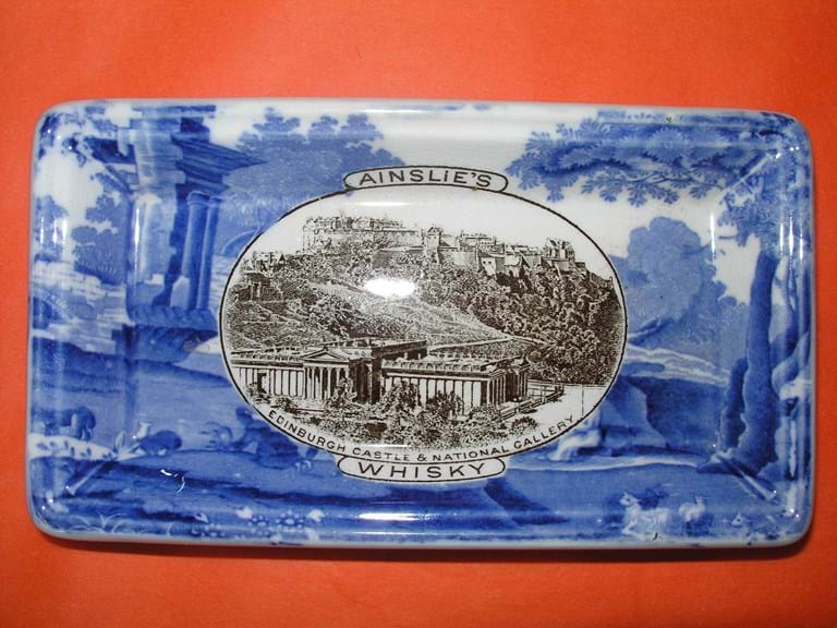 Copland Spode blue & white pottery advertising Ainslie's Whisky