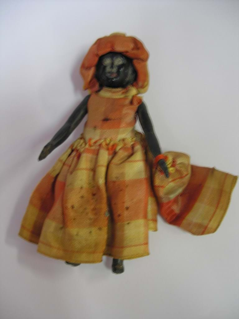 Early 20th century miniature celluloid black doll