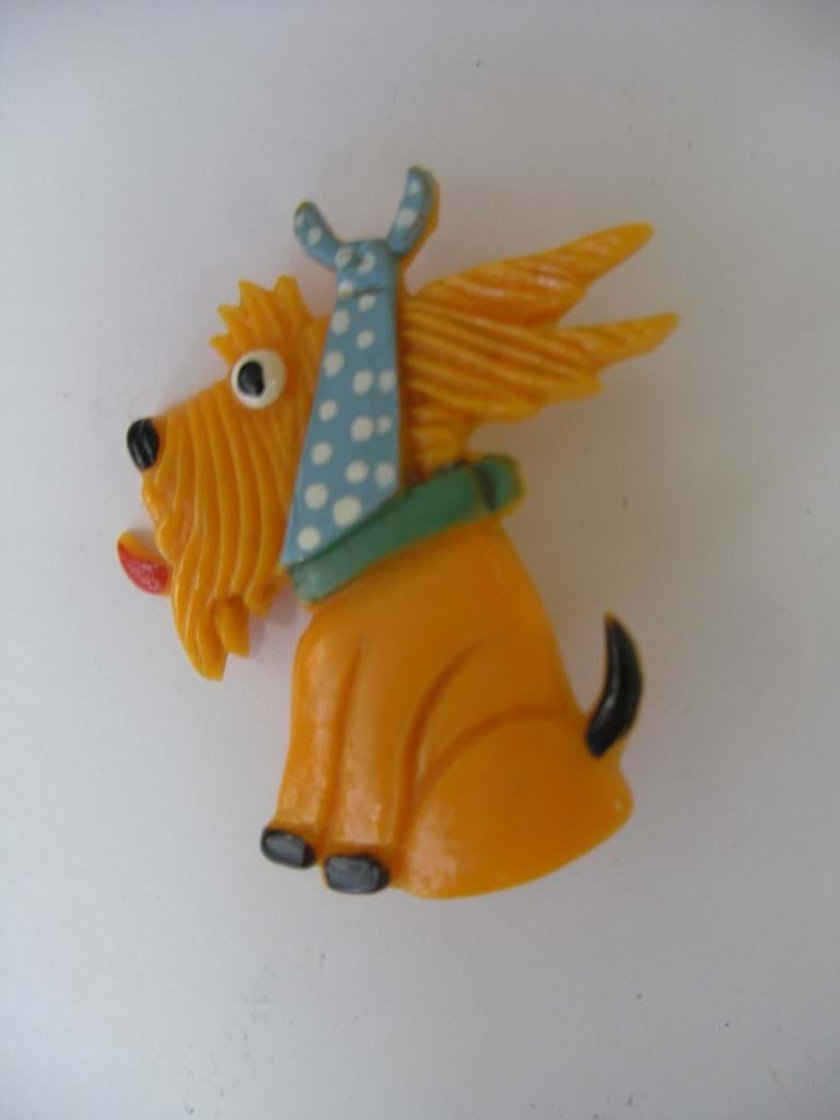 Celluloid comical dog brooch