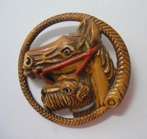 Celluloid horse and dog brooch
